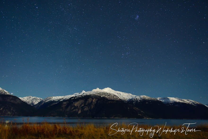 Scenic photo of stars and mountainside